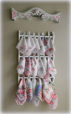 Ouch, can't say how many times I've passed up a spoon shelf...look at this makeover!  Display for my beautiful vintage handkerchiefs.  Souvenir spoon rack used for displaying hankies.