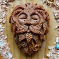 Stone Face Instead Of Throwing Away Avocado Pits, This Artist Carves Them Into Magical Forest Creatures Sculpture Sur Os, Sculpture Clay, Avocado Art, Forest Creatures, Magical Forest, Dark Forest, Bone Carving, Green Man, Ancient Art