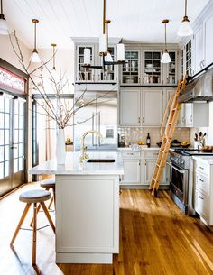 Kitchen with island and ladder