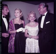 Grace Kelly with Oleg Cassini and Cesar Romero