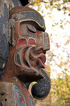 A part of an Native totem pole in Victoria's Inner Harbour, BC, Canada.