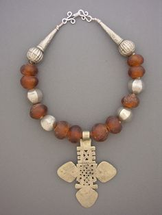 by Anne Holland | Antique Silver Ethiopian Coptic cross, combined with some Antique silver Ethiopian beads and recycled bottle glass beads from Africa