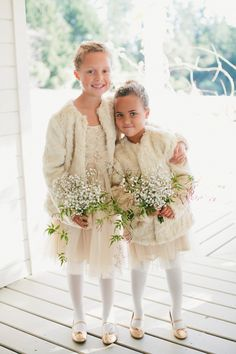the cutest flower girls decked out for a cold weather wedding Photography: Onelove Photography - onelove-photo.com  Read More: http://www.stylemepretty.com/2014/07/21/rustic-bonny-doon-wedding-with-scandinavian-traditions/
