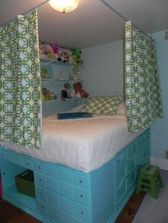 Claire's Bedroom - Repurposed Dressers used to lift bed, slats along wall hold…