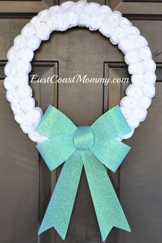 Elegant DIY Winter Wreath... so easy to make with this step by step tutorial!  Makes a great homemade gift for someone special.