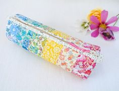 @ Sew Sweet Violet: Rainbow Liberty Print Pencil Case - purchase pattern here:  http://prettybyhand.bigcartel.com/product/pdf-round-pencil-case-pattern