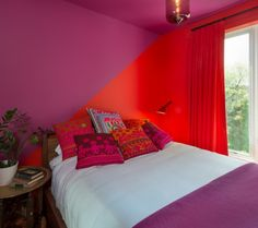 Red + Purple color combination in a Brooklyn brownstone bedroom