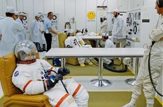 Apollo 16 John Young (foreground) and the other crewmembers undergo suit pressure integrity checks prior to launch. Deke Slayton (blue shirt) talks to the suit techs. Cosmos, Deke Slayton, Apollo Spacecraft, Apollo 16, Apollo Space Program, Apollo Missions, Anatole France, Cape Canaveral, Program Management