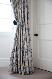 London Family Home, interior design by SGS Design Ltd. Blue and off-white floral linen curtains. Cabbages and Roses fabric.