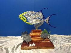 "Queen Triggerfish, Yellowtail Snapper & Gag Grouper - Standing Mount - Powder Coat  This Sculpture has a Trans Yellow, Purple Brown and Clear Powder Coat.  Triggerfish is 24"". The Gag & Yellowtail are 18"" inches.   https://themetaledge.com/trophies/queen-triggerfish-yellowtail-snapper-gag-grouper-standing-mount-powder-coat.html"