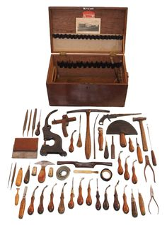 A WORKING SET OF LEATHER WORKING TOOLS including creasers, awls, a screw creaser, edge tools, a very nice saddler's hammer, a wooden draw gauge, a half-moon knife in a leather case, etc. This set of tools, all contained in a dovetailed walnut box, was used by a finisher at the Auto Painting and Trimming Company of Woodville, Massachusetts and it is in the same condition as when it was last used. From the Collection of Russell A. Bigelow, Winchester, New Hampshire.