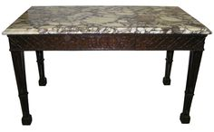 Go goth with this antique mahogany chippendale gothic center table