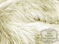 Ivory Mongolian Faux Fur www.thefabricexchange.com
