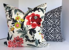 Decorative Pillow Covers in Waverlys Candid Moment Ebony (Floral) and Lace It Up Slub Ebony (Geometric)  Fabric #1: Waverlys Candid Moment Ebony (Floral) Colors include: pink, grey, charcoal, black, red, chartreuse and an ivory background. Fabric Content - 100% Medium/Heavyweight Basketweave Cotton Pattern: Horizontal Repeat: 0 Vertical Repeat: 18 Fabric #2: Waverlys Lace It Up Ebony (Geometric) Colors include: black and ivory. Fabric Content - 100% Medium Weight Slub Cotton Pattern: Hor...