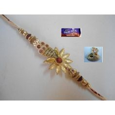 A Designer Rakhi especially crafted with Golden beads and Flowers. Send a Rakhi to you loved brother this Rakhi.    The Pack Contains:        * 1 Rakhi        * Free Roli and Chawal Pack        * Free Bar of Chocolate    Free Delivery Across India.    Send a Rakhi to you brother.