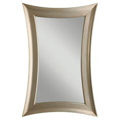 Take a detour from traditional design with this antique silver-leaf mirror. Graceful curved lines and sharply pointed corners provide an interesting juxtaposition of form that looks lovely hung either horizontally or vertically.