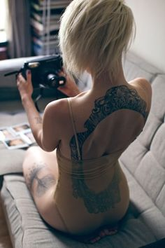 I'd never get it...but this back tattoo is SICK for somebody with a pretty back.