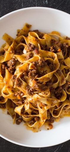 Weeknight Tagliatelle with Bolognese Sauce. In addition to passing grated Parmesan for serving, we stir ½ cup directly into the sauce to take advantage of its umami richness and help get it to the table quicker. Pasta Recipes, Beef Recipes, Dinner Recipes, Cooking Recipes, Healthy Recipes, Tagliatelle Recipes, Beef Dishes, Pasta Dishes, Food Dishes
