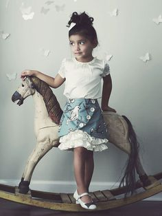 Pretty kids ruffle skirt@Patricia Cannon, patty you need a rocking horse for your pics!