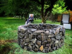 Gabion fire pit. DIY metal fabric. Produces a beautiful glow at night and allows just the right amount of air in to feed the flame.