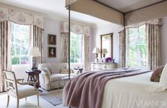 Romantic Air: Lavender accents and floral fabrics lend a romantic air to a guest room.