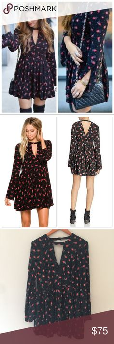 """NWOT Free People Tegan Printed Dress Cute Polka Dot and poppy flower print. Button enclosure at back. Hidden side zipper. 100% Rayon. NWOT- Button bag is still attached. Bust 42"""", length 33"""", sleeve length 25"""" Free People Dresses Mini"""