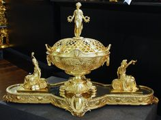 A Superb Silver-gilt table centrepiece Comprising a large flower-bowl and cover on mirror plateau with two detachable classical figures.  Fully hallmarked, By Elkington & Co. Birmingham 1889  A Pash and Sons - Fine Antique Silver, Objet d'art, fine bronzes, & furniture