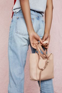 madewell small transport crossbody worn with the perfect summer jean.