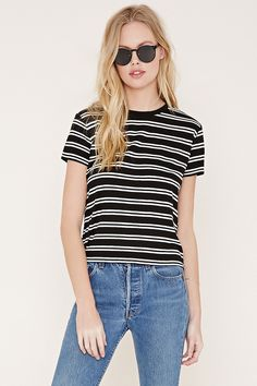 Style Deals - This boxy striped knit tee features short sleeves and a crew neck.