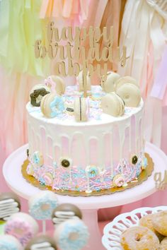 Donut themed cake from a Pastel Donut Birthday Party on Kara's Party Ideas | KarasPartyIdeas.com (26)
