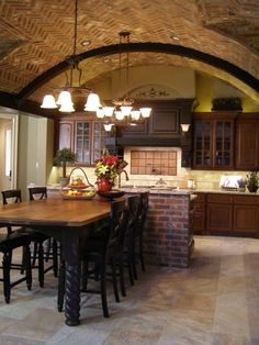 exposed brick wall, brick ceiling, island dining table