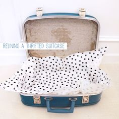 Relining a thrifted suitcase | crab+fish