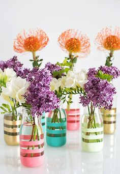 Upcycle glass bottles into vases with spray paint