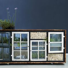 Green Room Divider - Sideboard To grow greens indoor, made of recycle wooden windows. Comes with LED light and plant trays Photo: Charlotte Schmidt Olsen