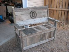 Custom bench from barnwood with brand on backrest