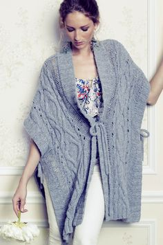 drape, deconstructed, slightly unwoven and cape-like sweater poncho for cold weather