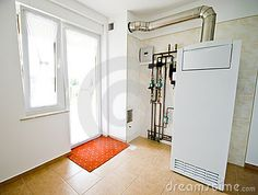 A view of a gas furnace or central heating system in a private home.  <a href='http://www.dreamstime.com/interiors-rcollection4789-resi208938' STYLE='font-size:13px; text-decoration: blink; color:#FF0000'><b>INTERIORS & REAL ESTATE COLLECTION »</b></a>