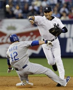 GAME 44: Wednesday, May 23, 2012 - New York Yankees shortstop Derek Jeter (2) throws to first after forcing out Kansas City Royals' Mitch Maier (12) when Alex Gordon grounded into a third-inning double play during their baseball game at Yankee Stadium in New York. (AP Photo/Kathy Willens)