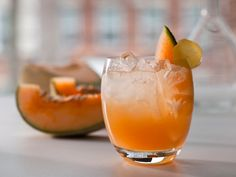 Cantaloupe-Ginger Spritzer: 1/2 cantaloupe, seeded, peeled and cut into large chunks, 1/3 cup sugar, 1/2 cup water, 6-inch piece fresh ginger root, peeled and cut into thick coins, 2 tbs. freshly squeezed lime juice, seltzer water or club soda, for mixing, thin cantaloupe wedges, and candied ginger pieces, for garnish (optional).
