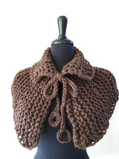 """Rustic neck warmer inspired by the Outlander Tv series. This capelet embodies a unique marriage between old world charm and modern sophistication. You can wear it under or over your favorite coat for warmth or with a dress. I knitted it from wool/acrylic mix yarn with matching sequins that add more uniqueness to this capelet.  Measurements: from neck to bottom - the yoke is approx.12""""(31cm) long.  You can find more capelets here…"""