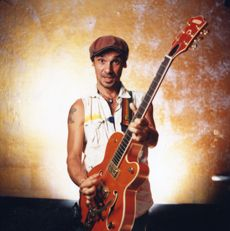 """""""Manu Chao (born José-Manuel Thomas Arthur Chao on June 21, 1961), is a French singer of Spanish roots (Basque and Galician). He sings in French, Spanish, English, Italian, Galician, Arabic and Portuguese and occasionally in other languages. Chao began his musical career in Paris, busking and playing with groups such as Hot Pants and Los Carayos, which combined a variety of languages and musical styles."""" - Wikipedia.org"""