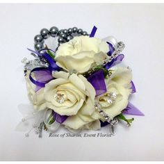 'Elegant' in Fayetteville Ar, Rose of Sharon Floral Designs. A timeless combination of miniature roses with pearl and diamond accents.