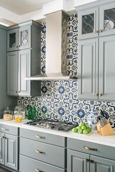 Blue and gray kitchen features gray raised panel cabinets adorned with brushed b. Blue and gray kitchen features gray raised panel cabinets adorned with brushed brass hardware paire Blue Kitchen Cabinets, Kitchen Wall Tiles, White Cabinets, Wood Cabinets, Modern Cabinets, Upper Cabinets, Patterned Kitchen Tiles, Ikea Cupboards, Patterned Wall