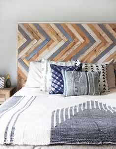 I have been so excited to make this project for my client's bedroom ever since spotting this wood wall. The concept of the herringbone pattern is pretty simple, but I thought there might be some chall