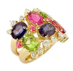 Ring in 18K yellow and white gold with round diamonds, blue sapphire, pink tourmaline, rubelite and peridot.