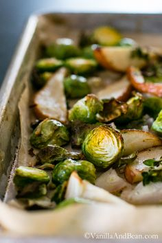 Brussels Sprouts are roasted until crisp with pears, shallots and thyme, then finished with toasty hazelnuts. Vegan + Gluten Free | Vanilla And Bean