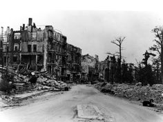 A street in Berlin, Germany, showing buildings damaged or destroyed by bombing in World War II. Ages Of Man, West Berlin, Post Apocalypse, Warts, Berlin Germany, Anthropology, Bitter, World War Ii, Ww2