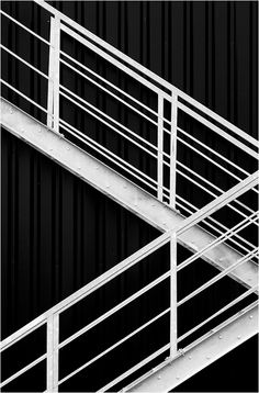 This image has RHYTHM because of the eye movement it makes your eyes like go down the steps.and your eyes are attracted to the steps.your eye go threw the art work and can imagine whats going down the steps.