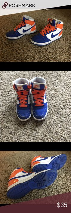 Nike high tops Blue and orange Nike high tops. Fairly worn, good condition, women's U.S. size 6.5 Nike Shoes Sneakers