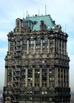 The abandoned Book Tower is a skyscraper in the Washington Boulevard Historic District of Detroit, MI. Construction began on the Italian Renaissance-style building in 1916 as an addition to the original Book Building and finished a decade later. Designed in the Academic Classicism style, it is 38 stories tall. The once opulent structure remains derelict although there was a proposal to renovate it last year in 2013. http://en.wikipedia.org/wiki/Book_Tower